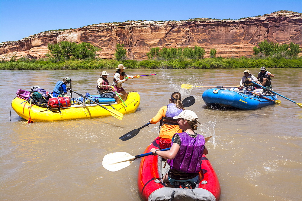 People Enjoying Water Fight While Rafting In The Colorado River