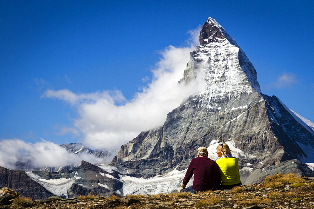 Couple Exploring Matterhorn Mountain On A Sunny Day