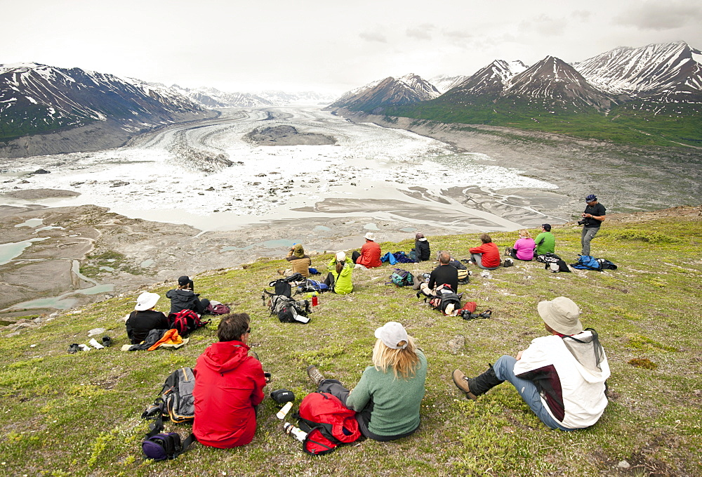 Group Of Hikers Relaxing On Goatherd Mountain Above Lowell Lake, Alsek River, Canada