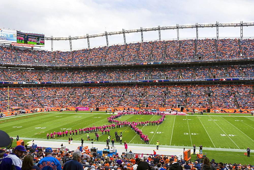 Women Create A Breast Cancer Awareness Ribbon On Sports Authority Field At Mile High Stadium