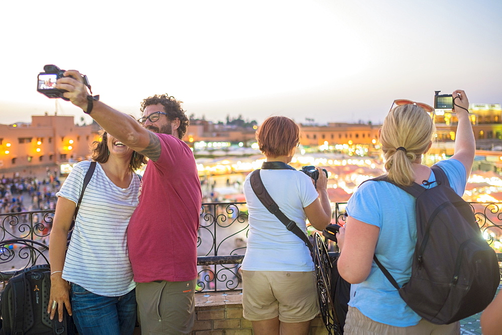 Tourists Take Selfies Above Bustling Djemaa El Fna At Night
