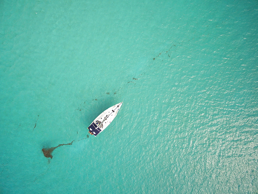 A Sailboat Rest In The Clear Waters Off The Coast Of The British Virgin Islands