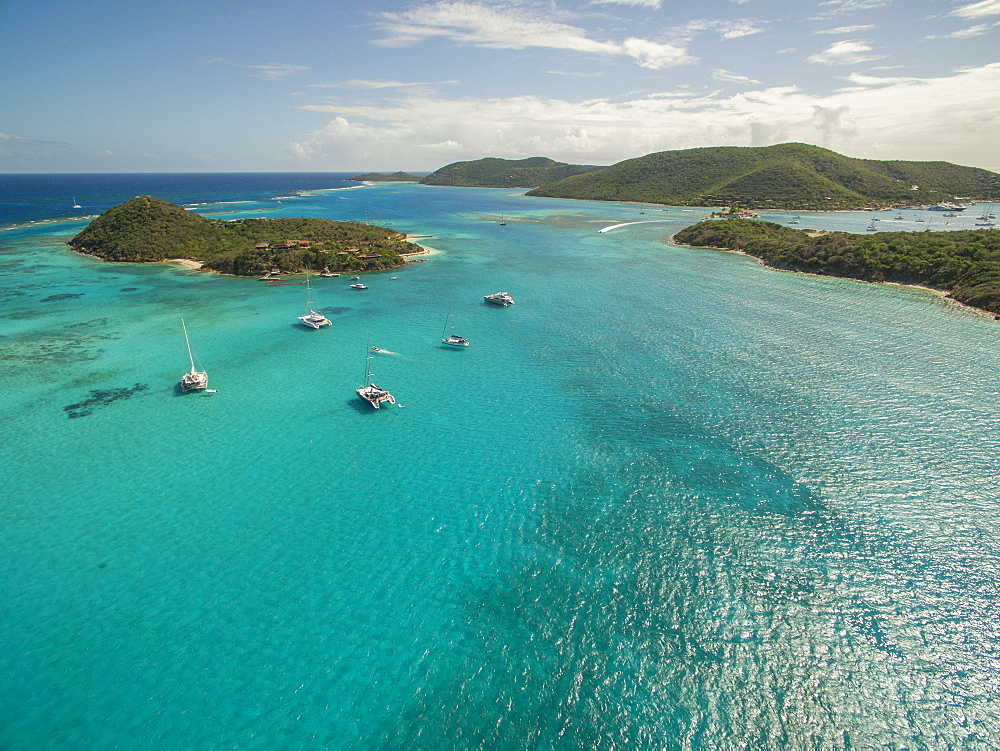 Sailboats Rest In The Clear Waters Near Prickly Pear Island In The British Virgin Islands