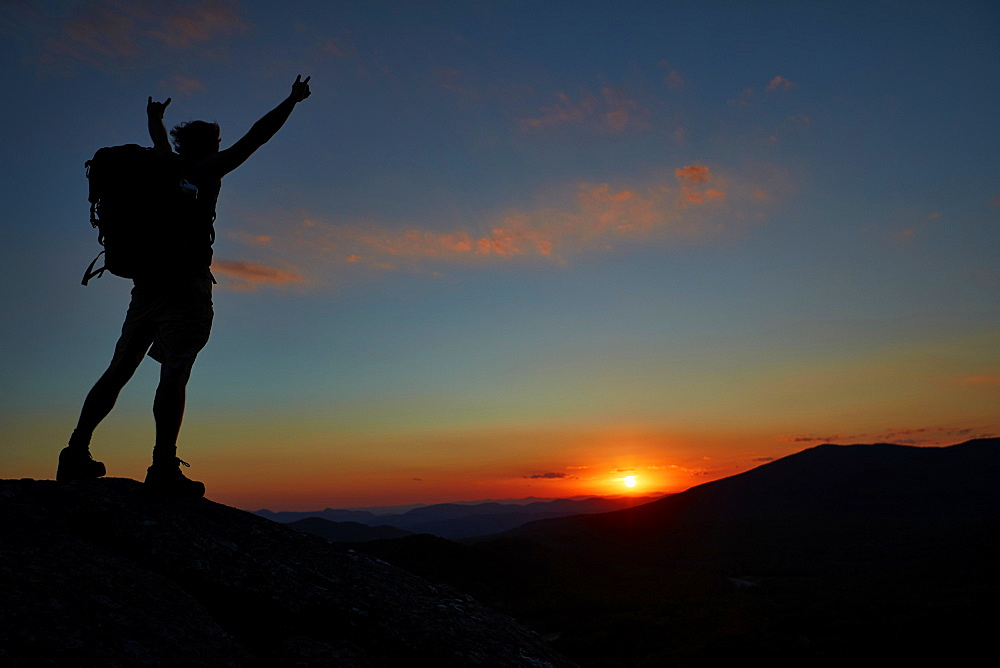 A Man Hikes Along The Appalachian Trail At Sunset
