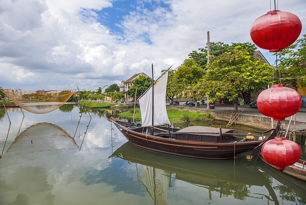 Traditional Vietnamese Boat Anchored In Hoi An