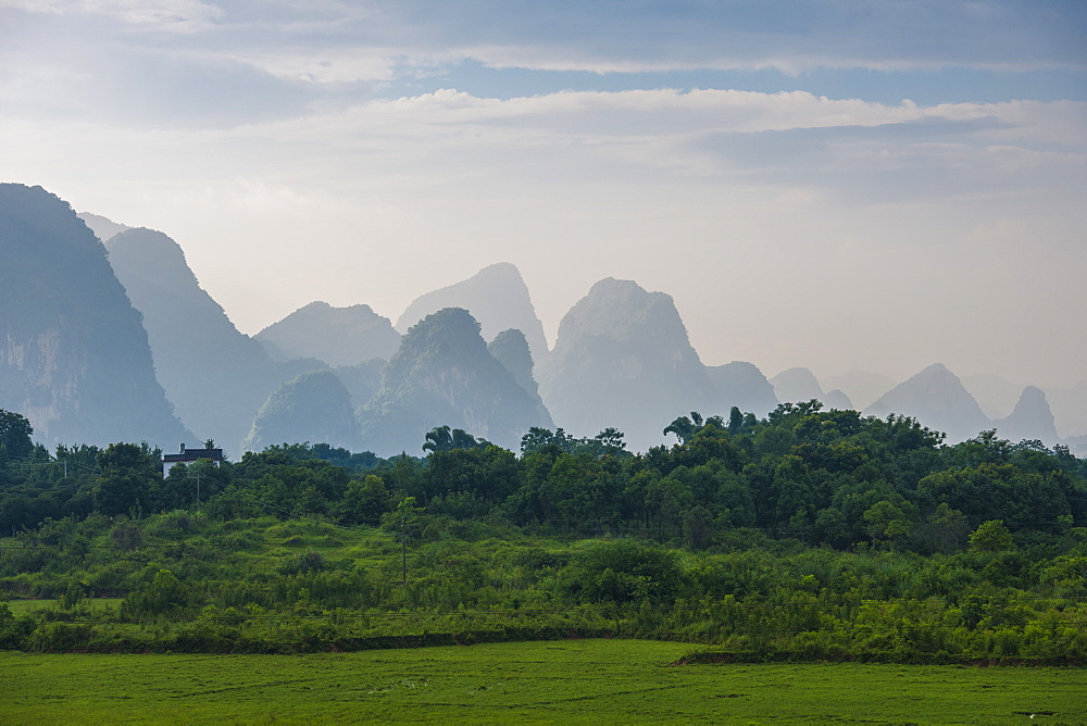 Karst Mountains Behind The Greenery Landscape In Guangxi Zhuang Autonomous Region