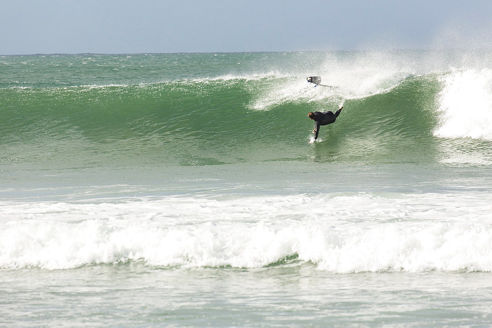 A Male Surfer Wipes Out On A Wave While Surfing In Jeffrey's Bay, South Africa