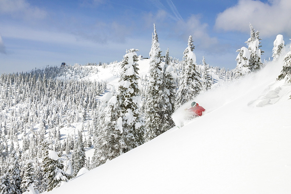 Male Skier Makes A Deep Powder Turn On Snowy Landscape In Whitefish, Montana, Usa