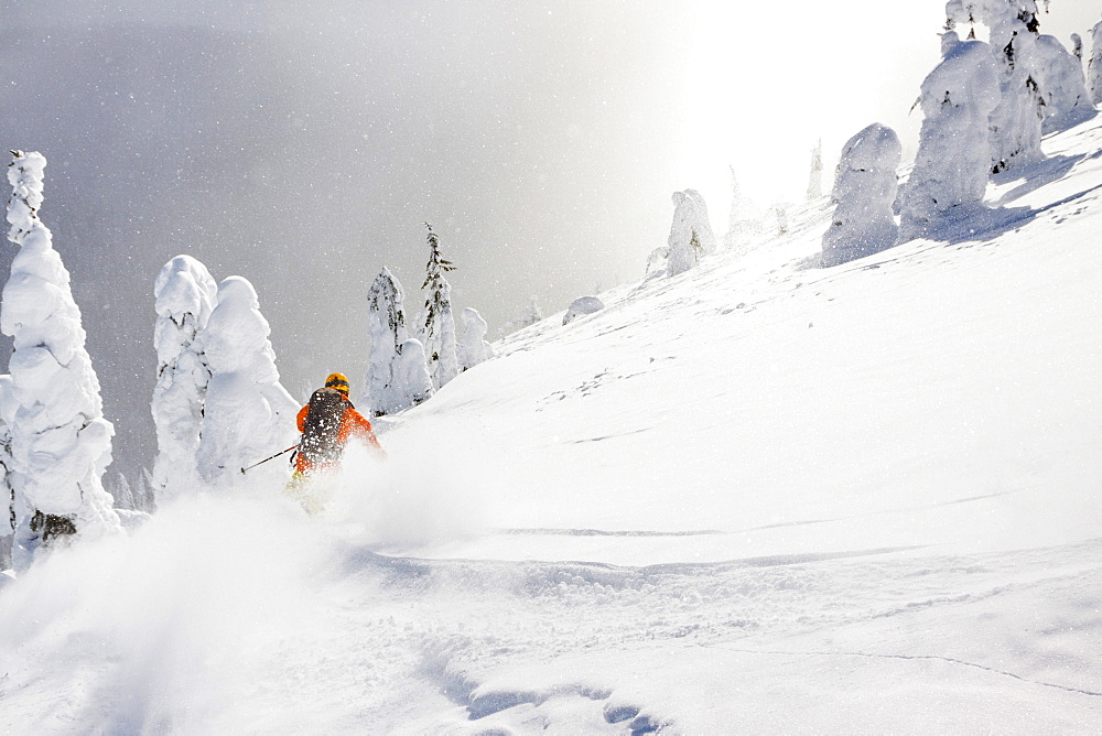 Male Skier Skiing On Deep Powder Turn In Whitefish Mountain Resort