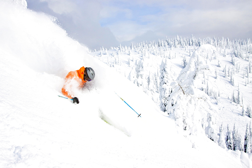 Male Skier Makes A Deep Powder Turn In Snowy Landscape At Whitefish, Montana, Usa