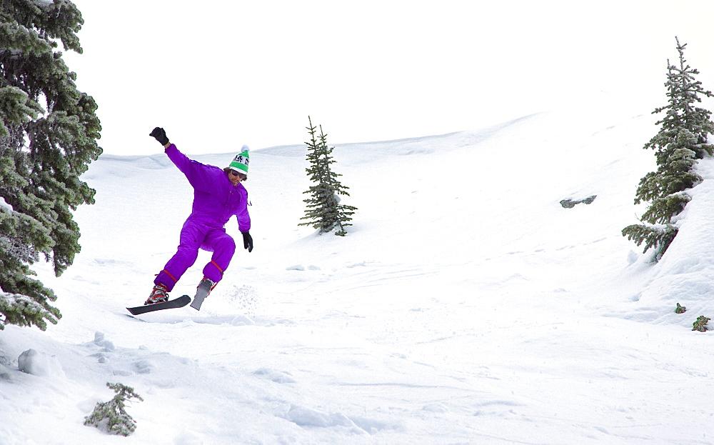 Male Skier Skiing On Snowy Landscape