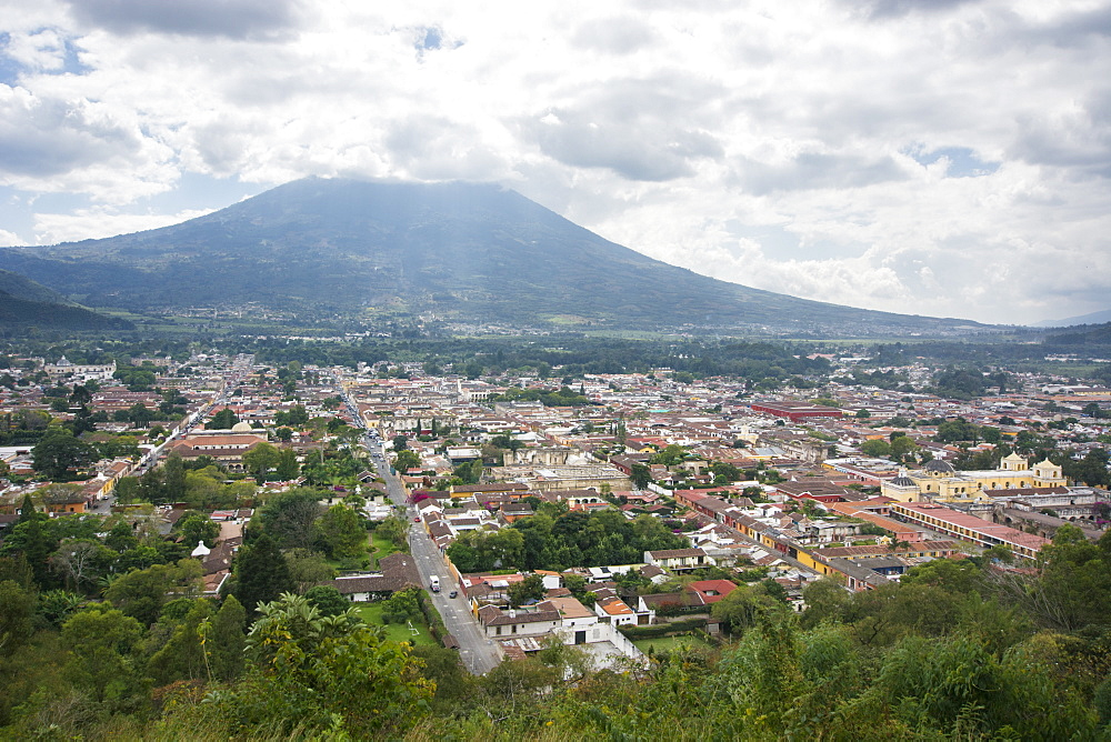 View Of The Antigua City With The Top Of The Volcan De Agua Covered By Clouds In The Background