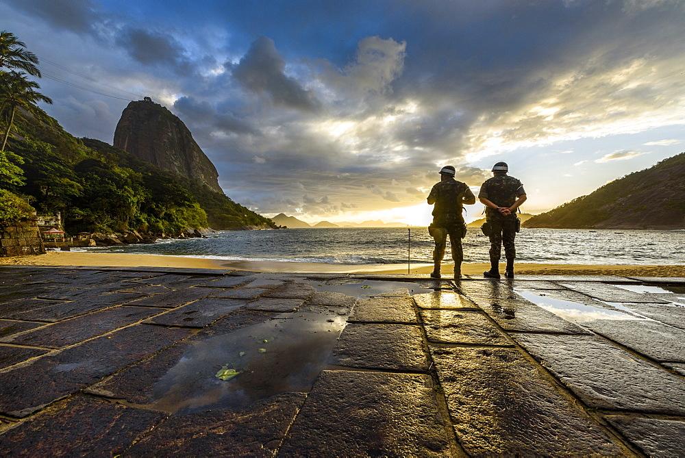 Two Military Soldiers At Praia Vermelha Beach During Sunrise