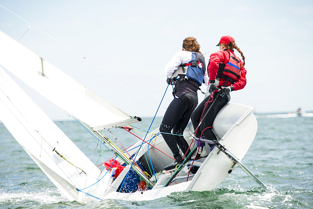Two Teenage Girls Sailing Boat At Narragansett Bay As Part Of Junior Sailing Program