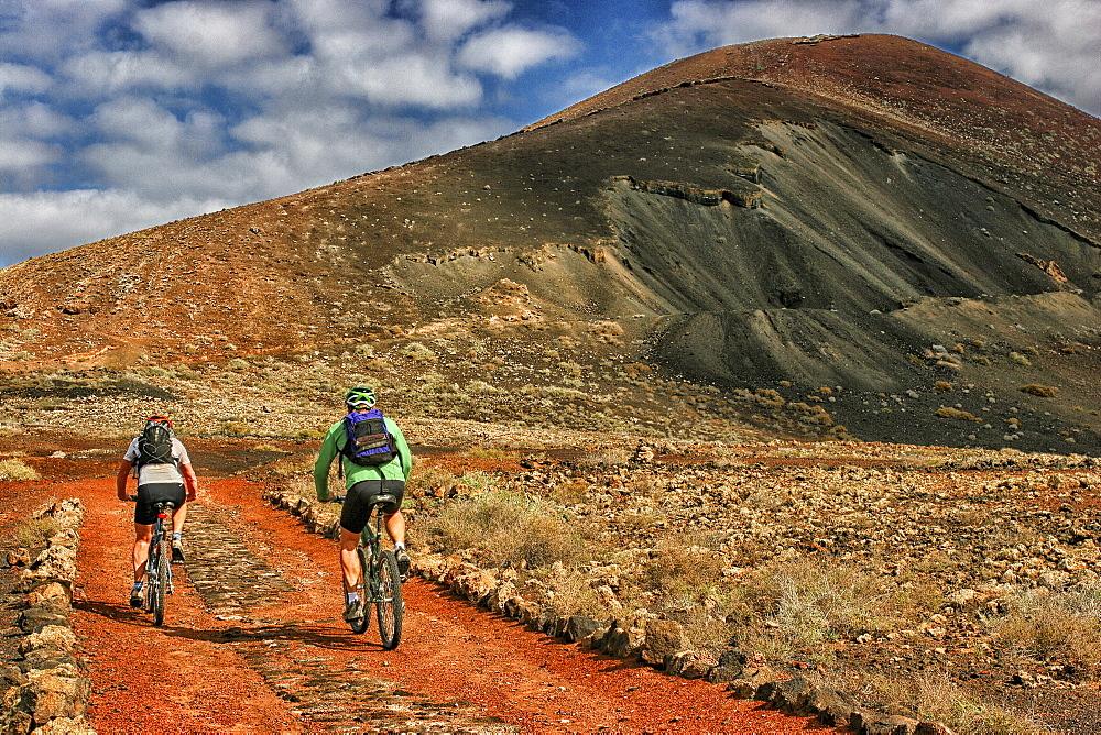 Two Mountain Bikers On The La Oliva, Fuerteventura, Spain