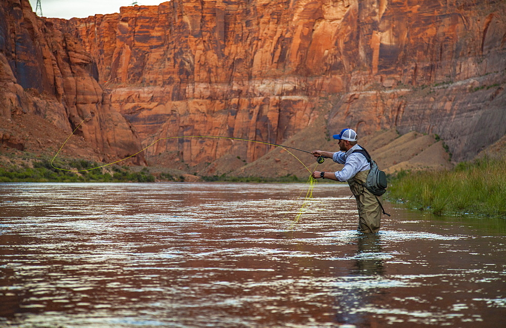 Man Fly Fishing On The Colorado River In The Grand Canyon