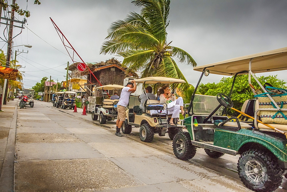 Convoy of golf carts in San Pedro, Belize
