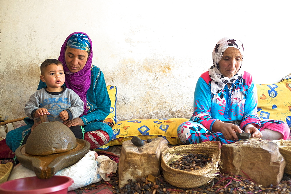 Two Berber Women In Traditional Clothing Extract Argan Oil From Kernels Of The Argan Tree