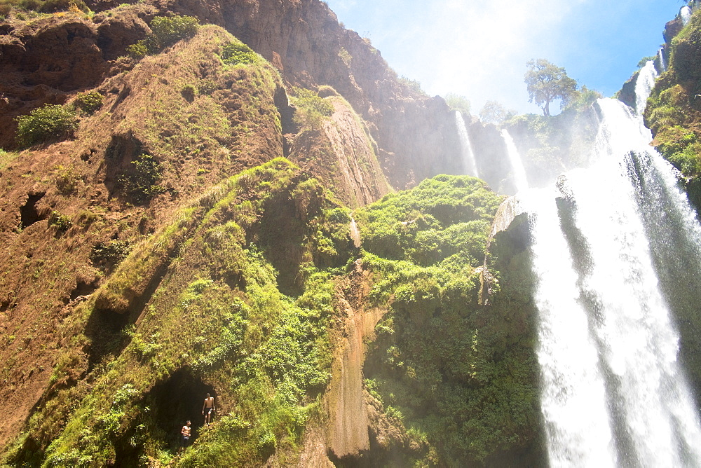 Two Boys Getting Ready To Jump From High Above The Water Next To Cascades Douzoud Waterfall