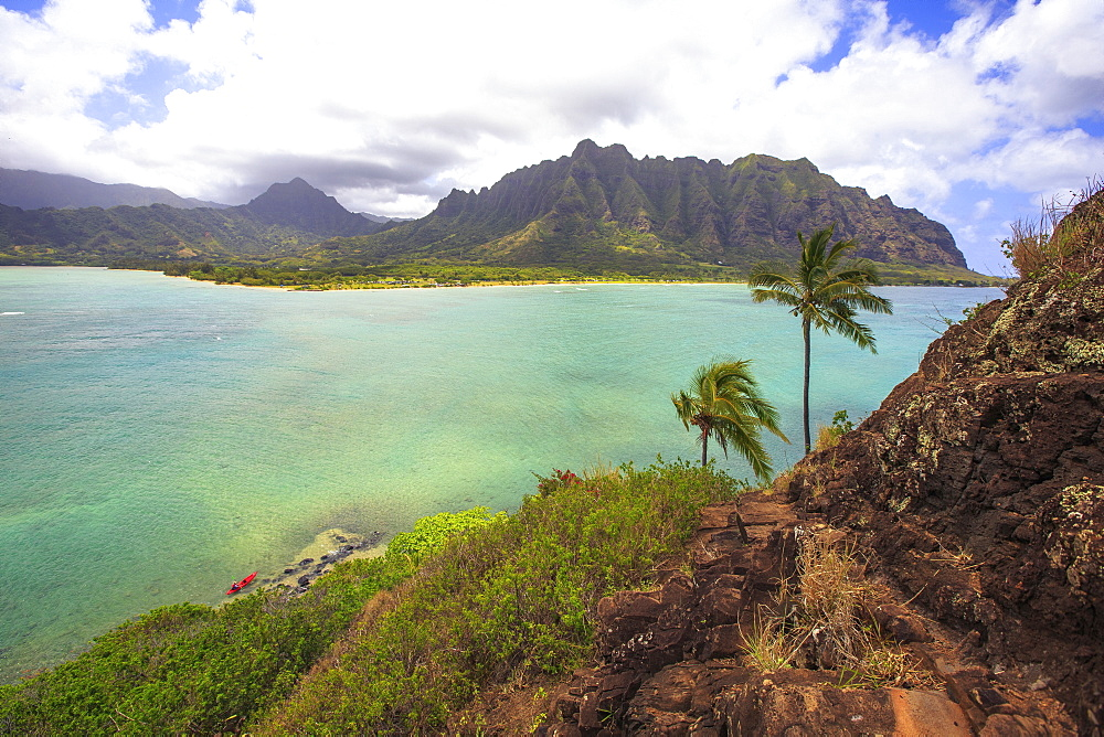 A Kayak Sitting On The Shore Of Mokolii In Oahu, Hawaii