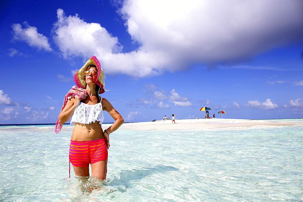 Tourist Exploring Beach Around A Small Sandbank Of Gulhi, Maldives