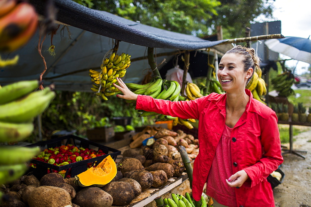 Young Woman At A Fruit Market On A Roadside In Puerto Rico