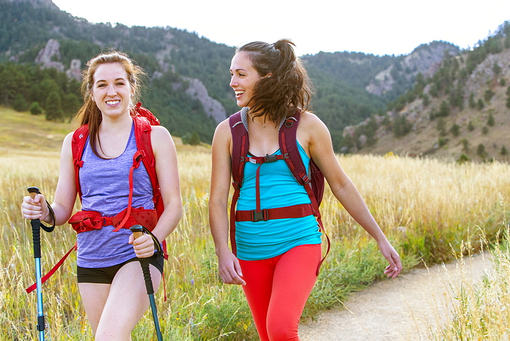 Portrait Of Two Female Hiker Smiling While Hiking On Trail In Colorado