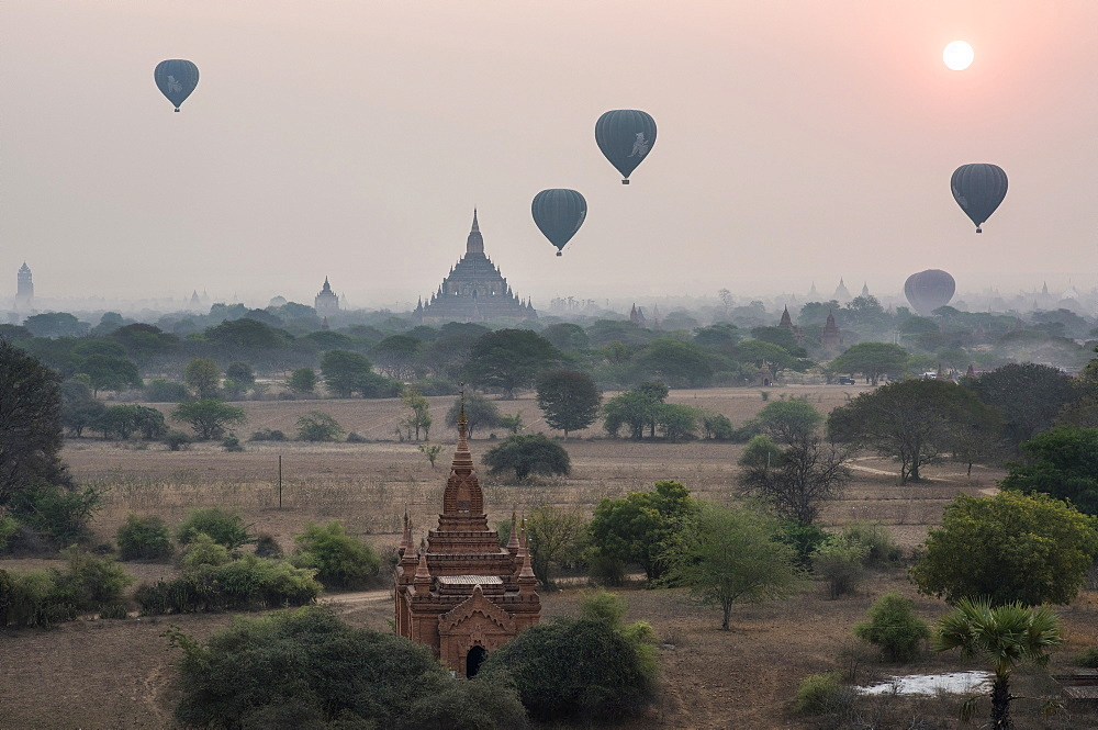 Hot Air Balloons Flying Over The Temples Of Bagan In Myanmar