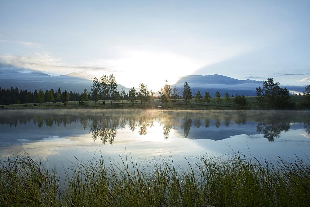 Sunrise reflected in mountain lake