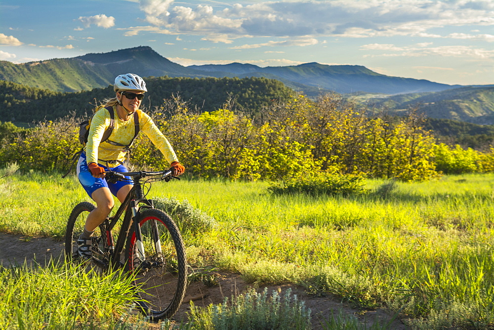 A woman mountain biking on the Horse Gulch Trail System, Durango, Colorado