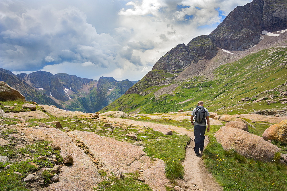 A Man Hiking Through Chicago Basin
