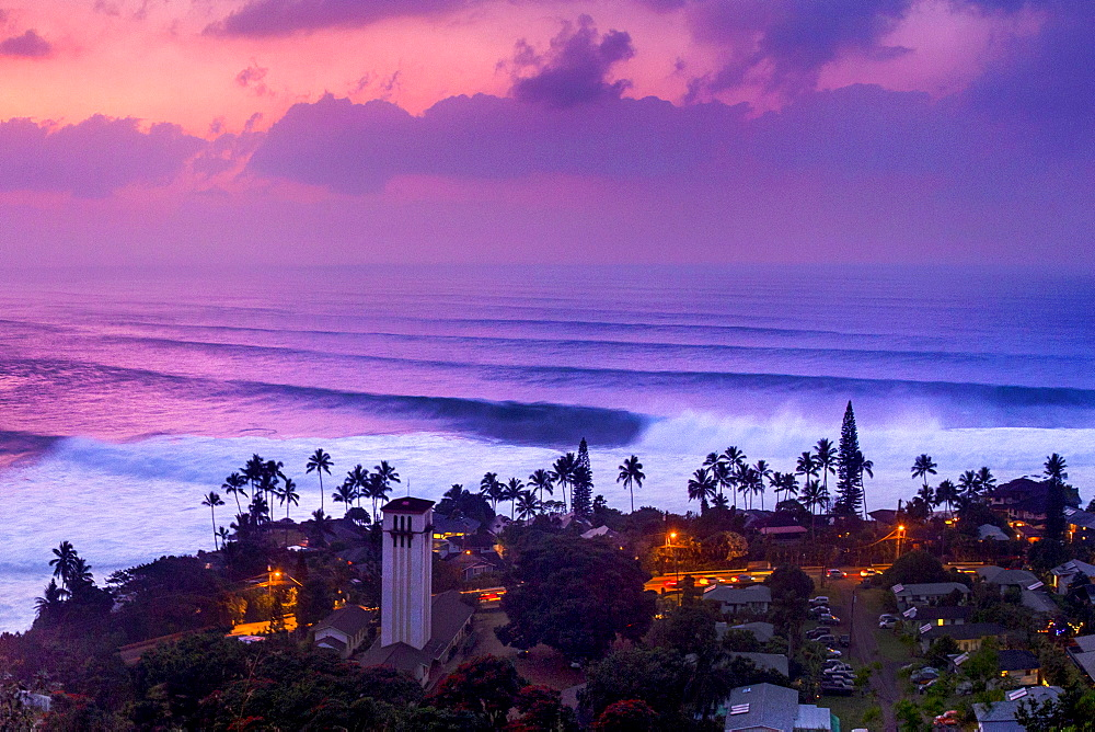 Aerial view of huge waves in Waimea Bay during dramatic sunset