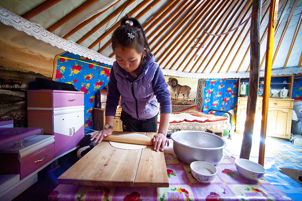 June 13, 2011 / Mongolia / young girl cooking in the yurt - 857-94186