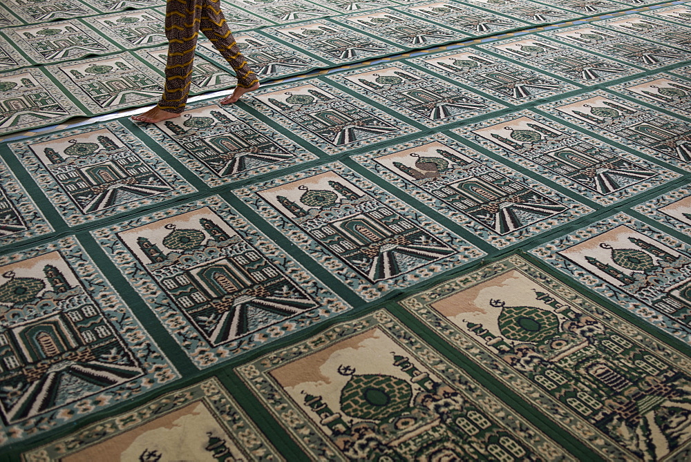 A Person Walking On Top Of Muslim Praying Carpet Inside The Grand Mosque, Medan, Sumatra, Indonesia
