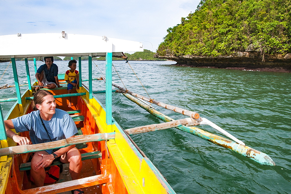 Woman Riding On Boat Through Hundred Islands National Park, Luzon, Philippines