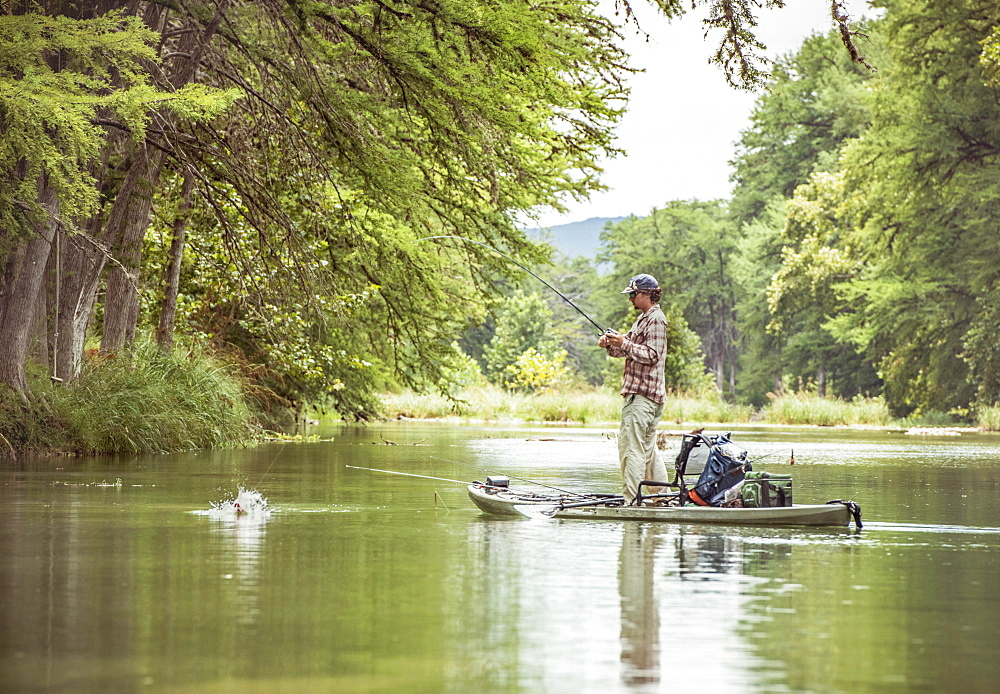 Joseph catches a bass in the texas hill country