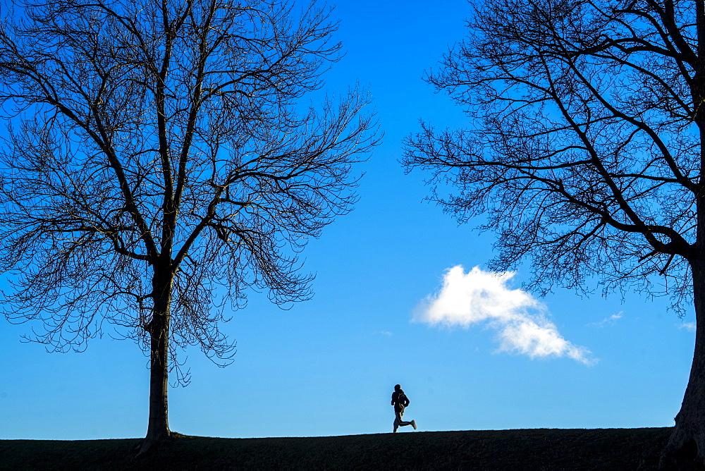 A man running at Copenhagen's historic Kastellet.