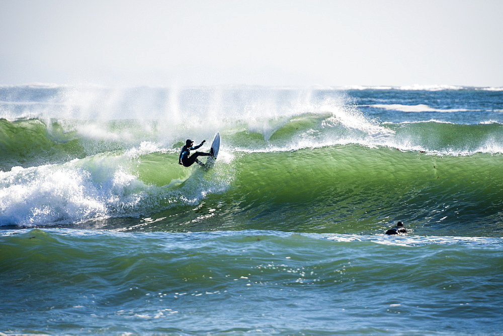 Man surfing large winter swell in Rhode Island