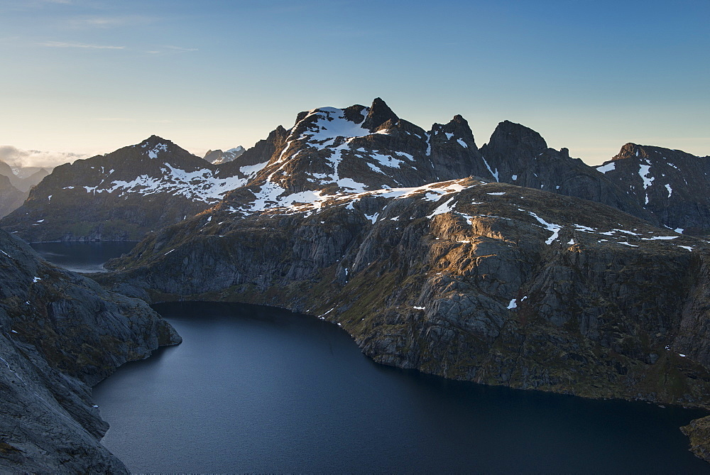 View over Fjerddalsvatnet lake towards Munken and surrounding mountains, Moskenesøy, Lofoten Islands, Norway
