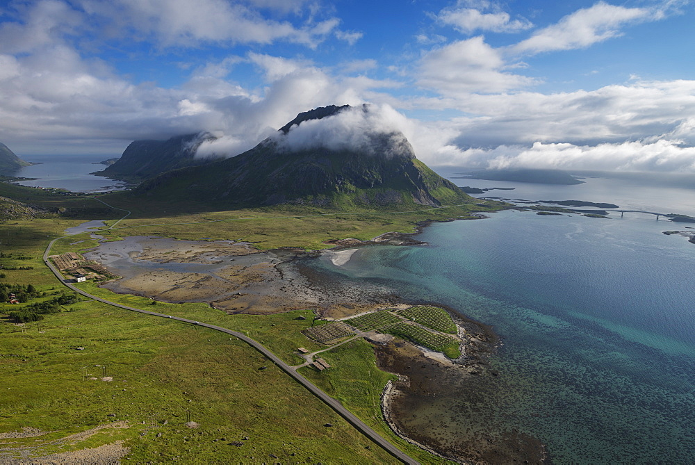Highway E10 winds its way below Volandstind mountain peak, Flakstadøy, Lofoten Islands, Norway