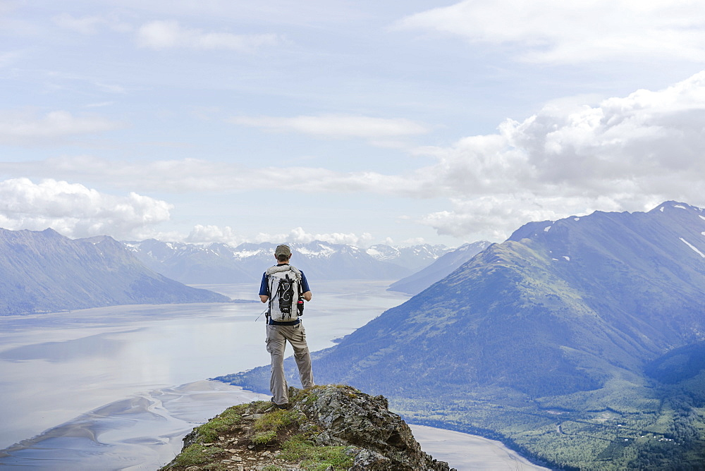 Make hiker at Hope Point in Chugach National Forest Alaska overlooking Turnagain Arm