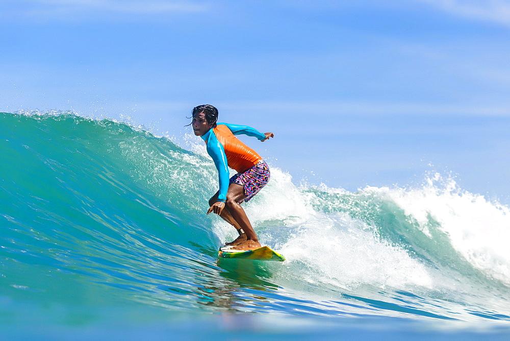 Female surfer on wave