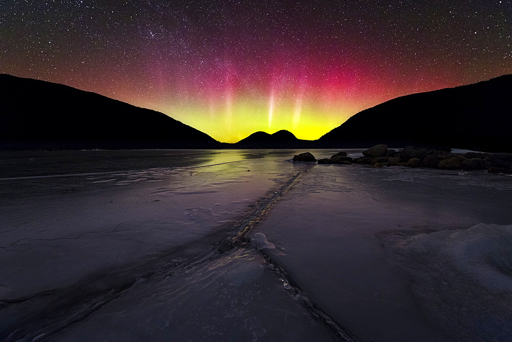 The Northern Lights over frozen Jordan Pond in Acadia National Park.