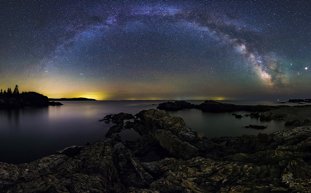 A Milky Way panorama over the ragged coast of Down East Maine.