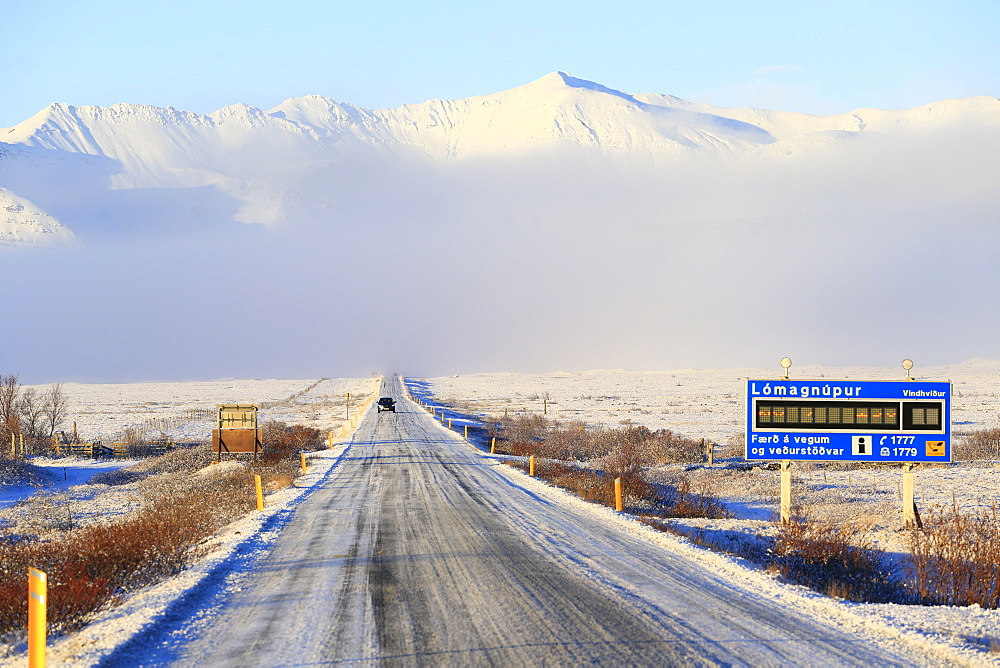 Route 1 road and road weather information sign at Skaftafell, southeast Iceland in winter