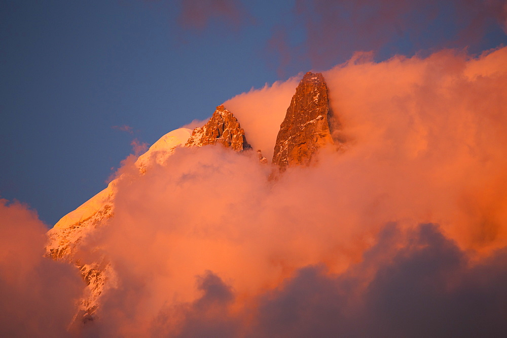 Pink evening light (Alpenglow) on the famous Drus mountain, as seen from Chamonix.