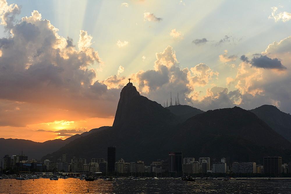 Sunset behind Morro do Corcovado and Cristo Redentor seen from Urca, Rio de Janeiro, Brazil