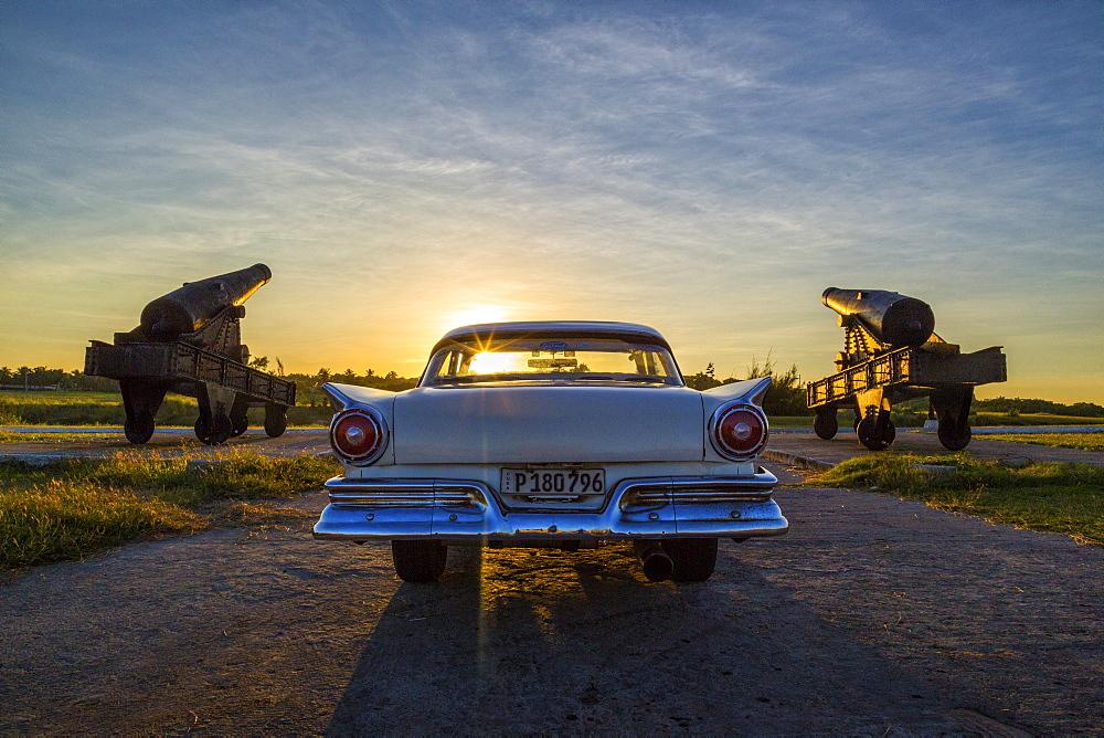 Ford Fairlane parked by canons of Castillo de Tres Reyes, Havana Cuba
