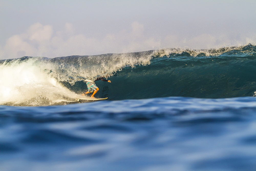 Photograph of surfer riding wave, Lakey Peak, central Sumbawa, Indonesia