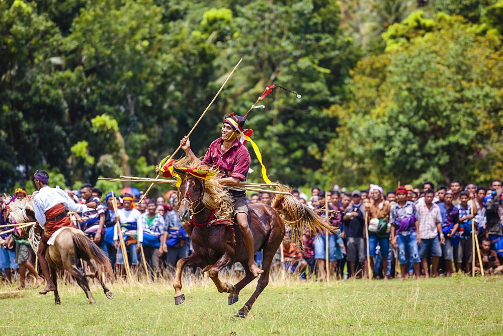 Men on horses competing in Pasola Festival, Sumba island, Indonesia